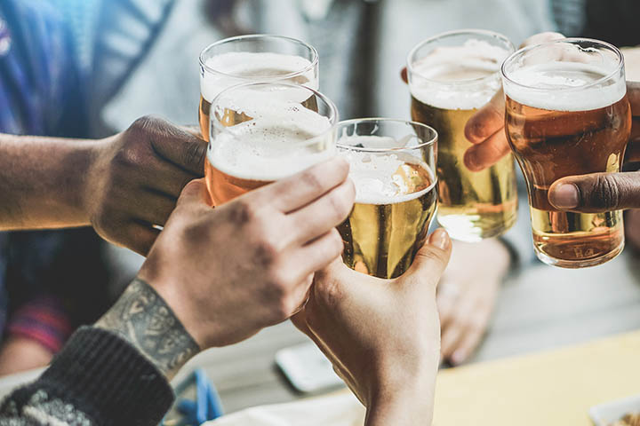 """Hands holding beer and """"cheers""""-ing"""